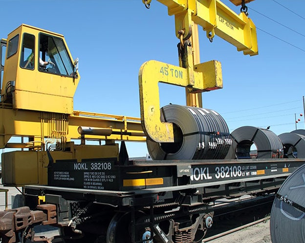 Transloading coil from rail cars to trucks