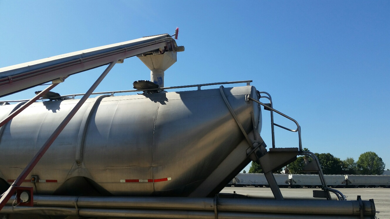 Malt is transferred to from a rail car to a truck at the UPDS Valla Railport in Santa Fe Springs, California.