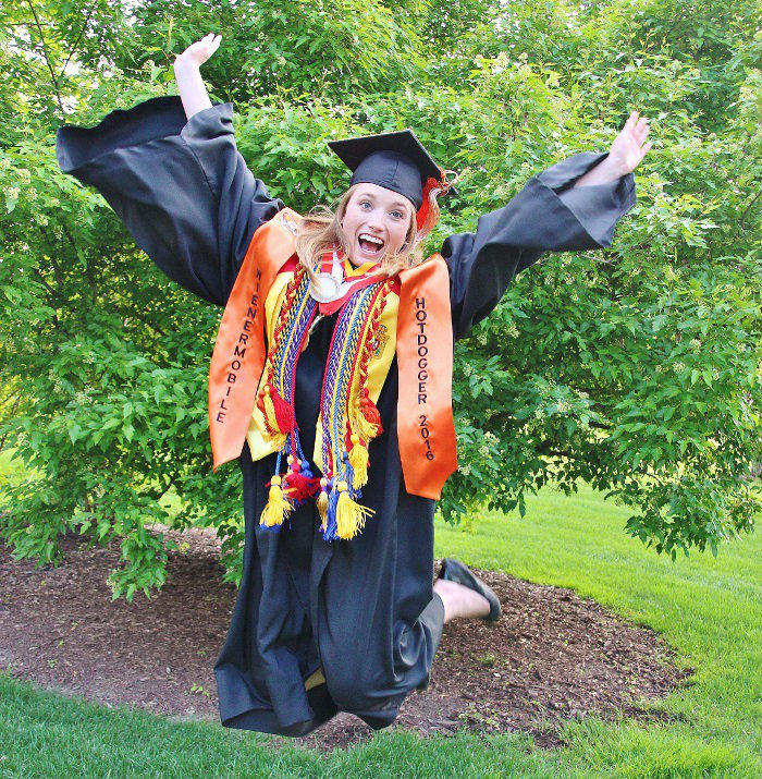 UPDS Logistics Service Representative Ashley Eisert celebrates her graduation from UNO — and her next adventure driving the Oscar Mayer Wienermobile.