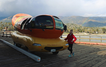 Ashley poses with the Oscar Mayer Wienermobile at the Stearns Wharf Pier in Santa Barbara, California.